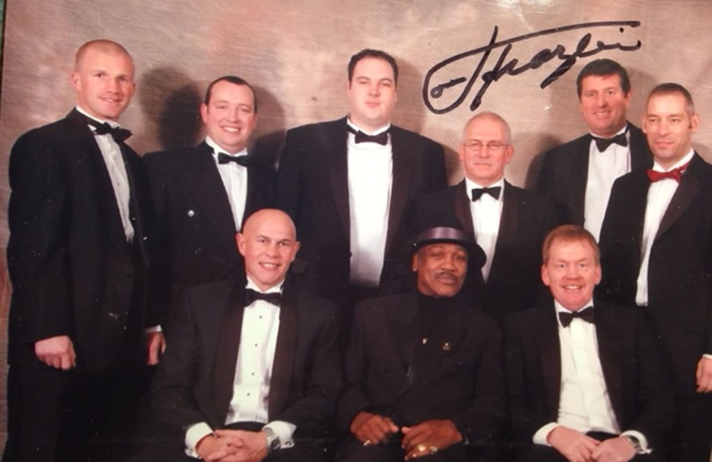 Coaches with the legendary Joe Frazier